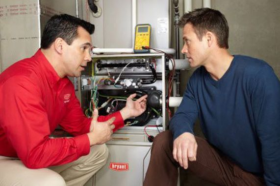 Professional explaining the customer about Heating Systems