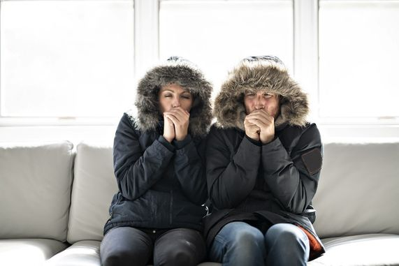 Two people cold in a house.